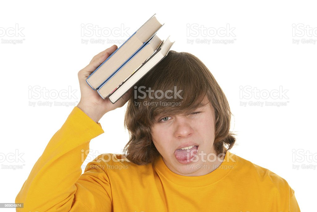 Dissatisfied teenager with book royalty-free stock photo