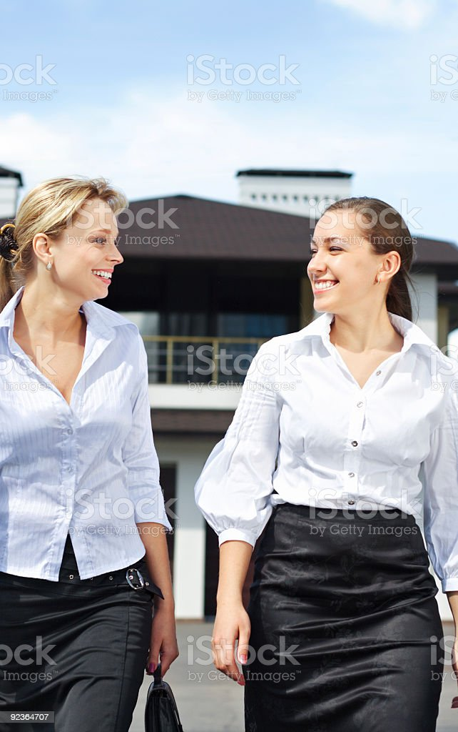 Disscussion between two businesswomen royalty-free stock photo