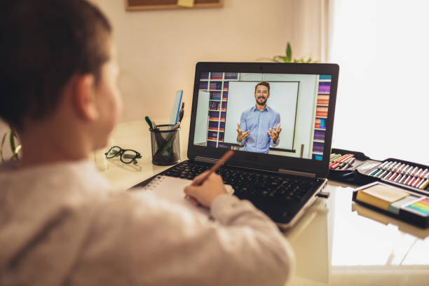 Distance learning online education. Distance learning online education. A schoolboy boy studies at home and does school homework. A home distance learning. showing stock pictures, royalty-free photos & images
