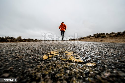 A man running on a paved road