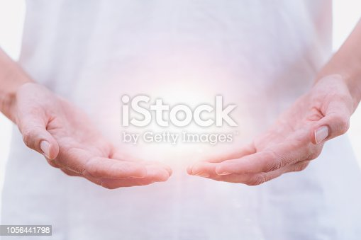 Close up horizontal image of distance healing hands of therapist at Reiki healing treatment. Alternative therapy concept