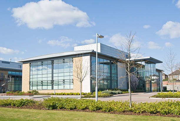 A distance shot of a glass walled office building stock photo