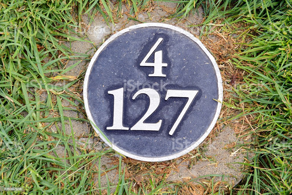 Distance yardage marker on Golf course in tee box stock photo