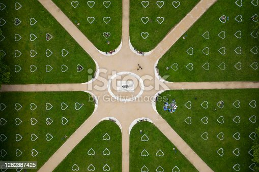 Distanced illustrated hearts for social distancing in public park during coronavirus