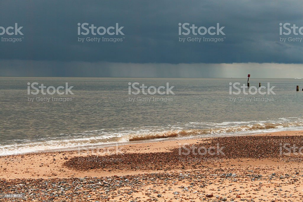 Distant Black Cloud at Beach stock photo