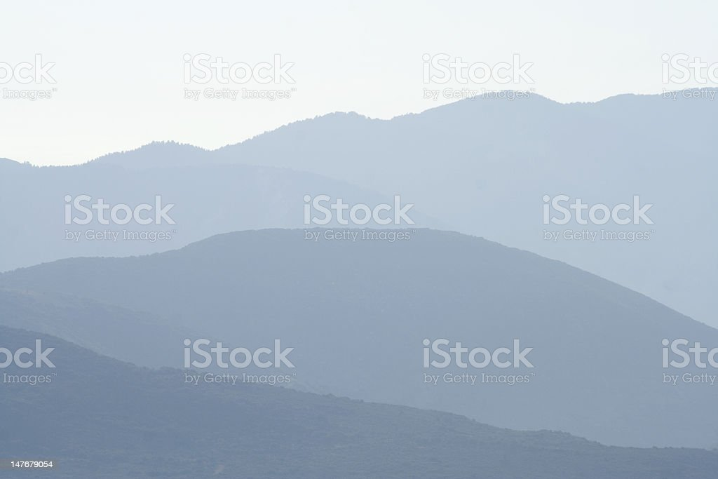 Distant hills - misty background royalty-free stock photo
