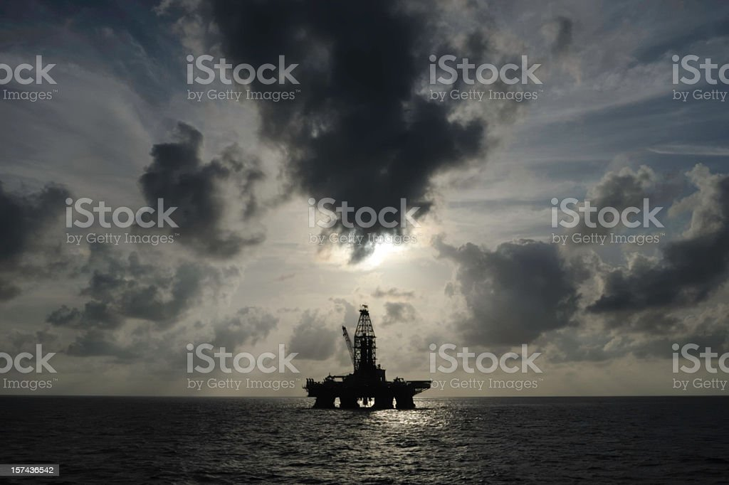 Distant offshore oil rig with skyscape stock photo
