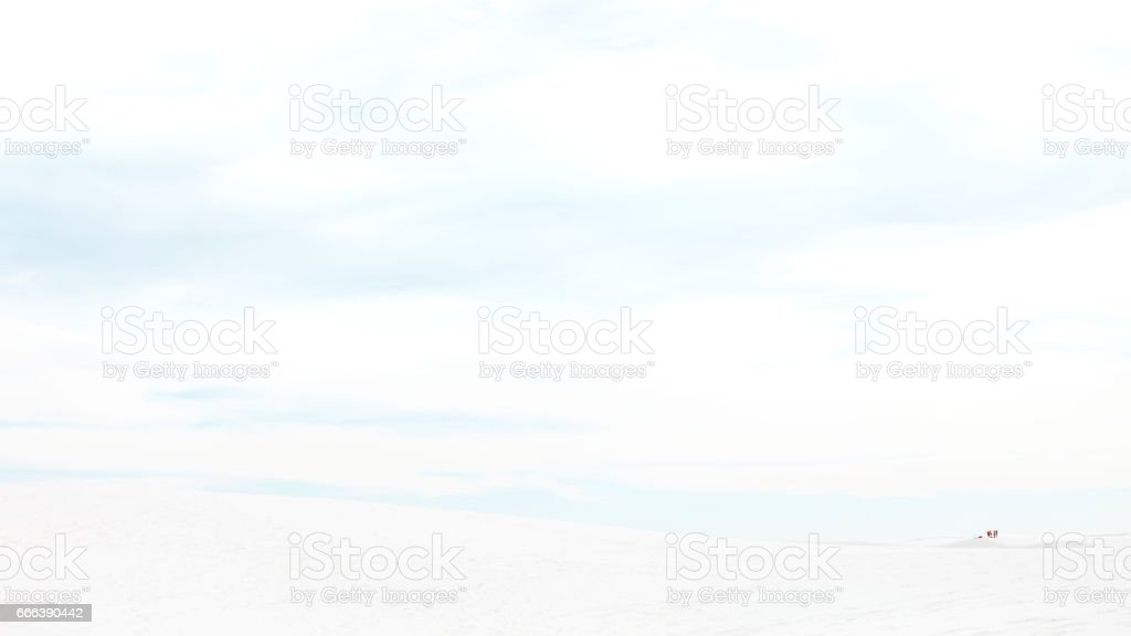 Distant people on White Sands - New Mexico. stock photo