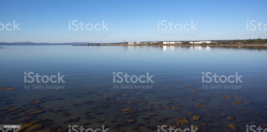 Distant pier at Searsport in the summertime stock photo
