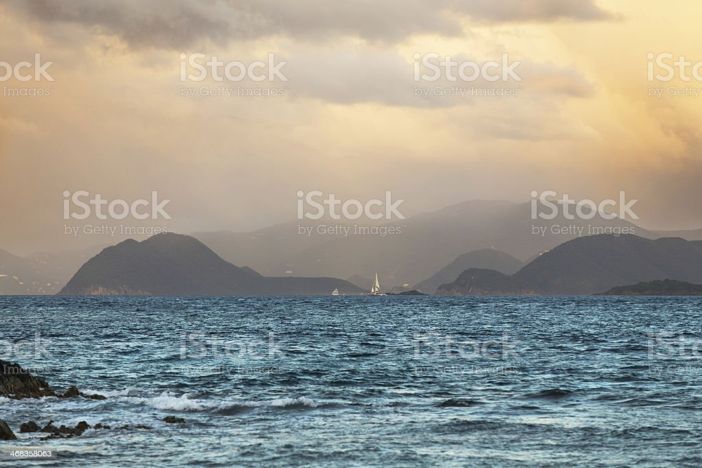 Distant Sailboat at Sunrise royalty-free stock photo