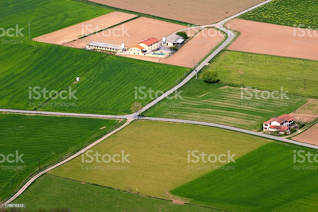 Distant shot of the country side with wide spread farms stock photo