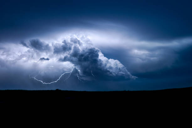 a distant storm at the border of north - and south dakota produces beautiful lightning bolts - extreme weather stock pictures, royalty-free photos & images