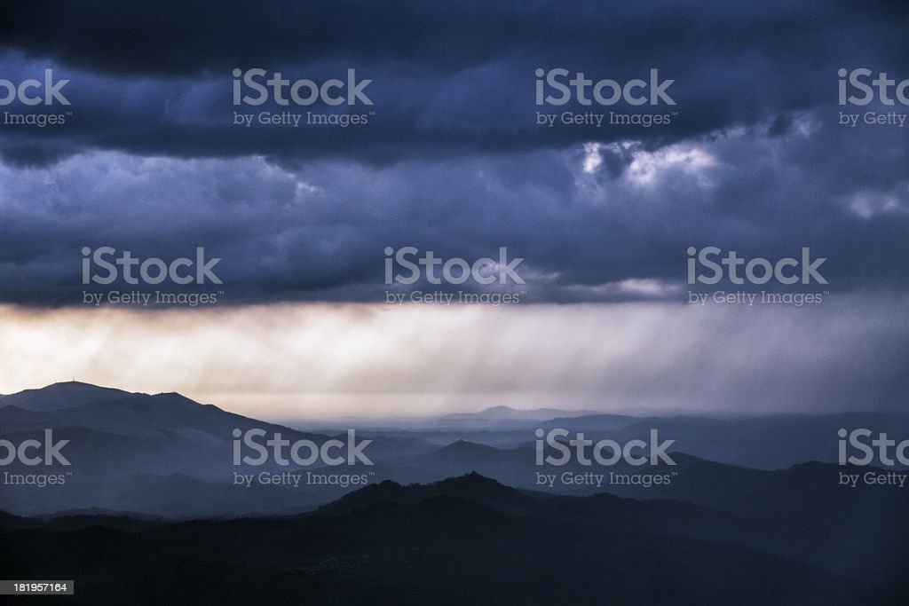 Distant sunset rain storm from the hilltop royalty-free stock photo