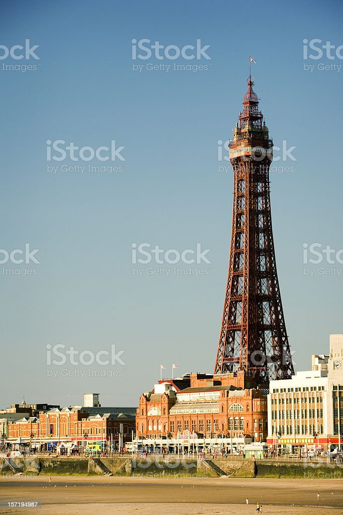 Distant view of Blackpool Tower under clear, blue sky.  stock photo