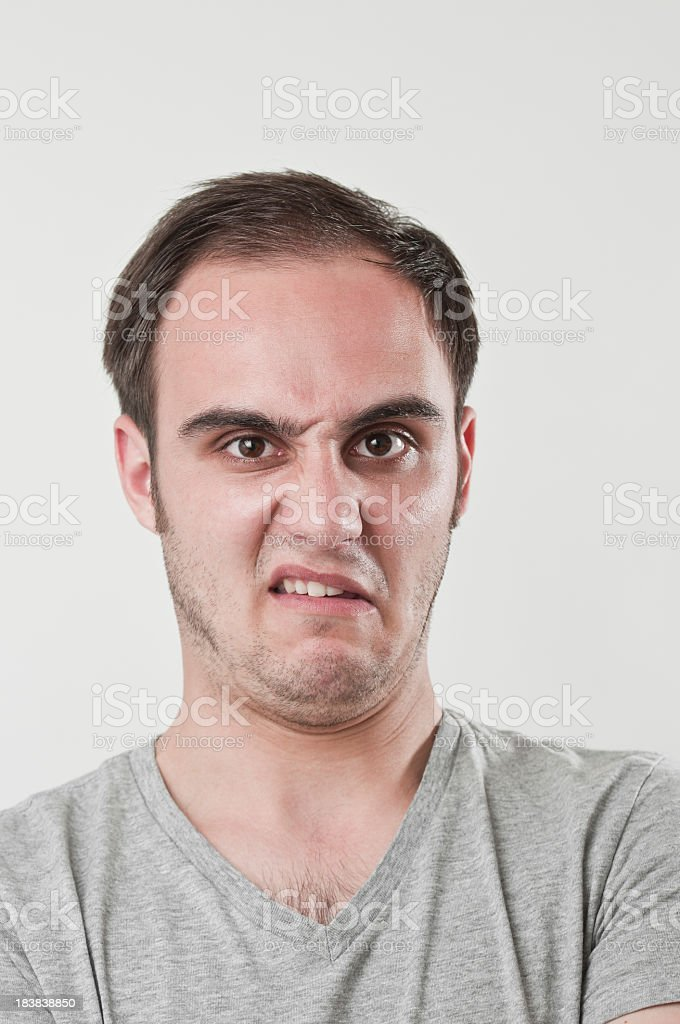 Distaste expression on man face stock photo
