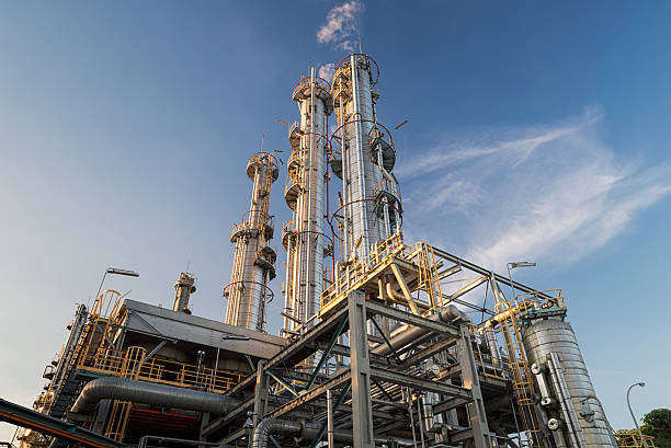 distillation columns and their process equipments - refinery stock photos and pictures
