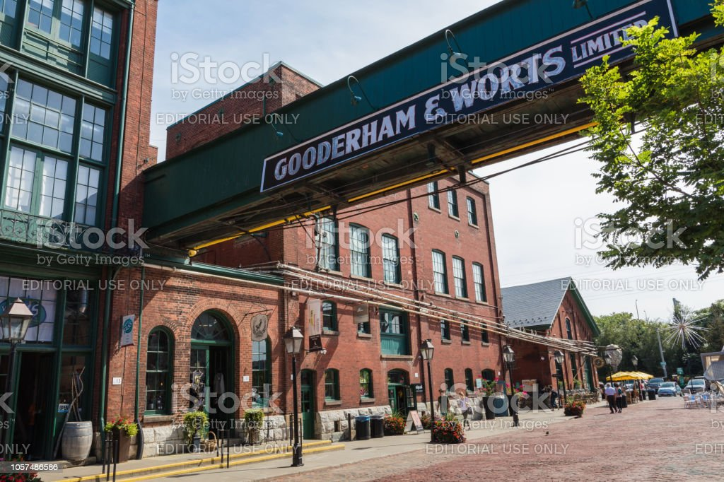 TORONTO, CANADA - SEPTEMBER 18, 2018: Distillery District (former Gooderham & Worts Distillery) - historic and entertainment precinct. It contains numerous cafes, restaurants, shops and industrial parts. TORONTO, CANADA - SEPTEMBER 18, 2018: Distillery District (former Gooderham & Worts Distillery) - historic and entertainment precinct. It contains numerous cafes, restaurants, shops and industrial parts. Architecture Stock Photo