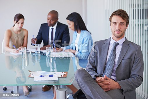 Portrait of a young businessman with his colleagues having a meeting in the backgroundhttp://195.154.178.81/DATA/istock_collage/0/shoots/785310.jpg