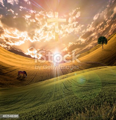 istock Distorted field with cross in sky and shining white figure 452546095