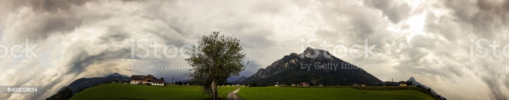 Distorted Panorama of Dramatic Landscape in the Austrian Alps stock photo