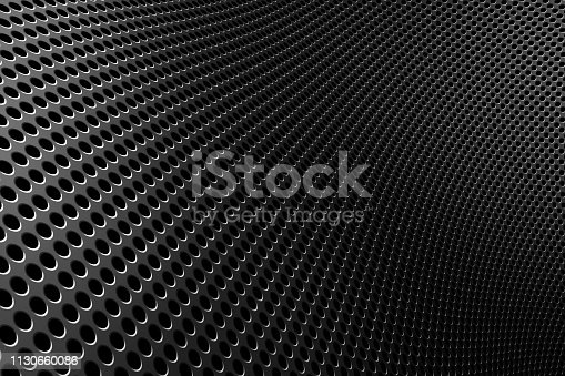 849490554istockphoto Distorted perforated metal plate on surface under angle 1130660086