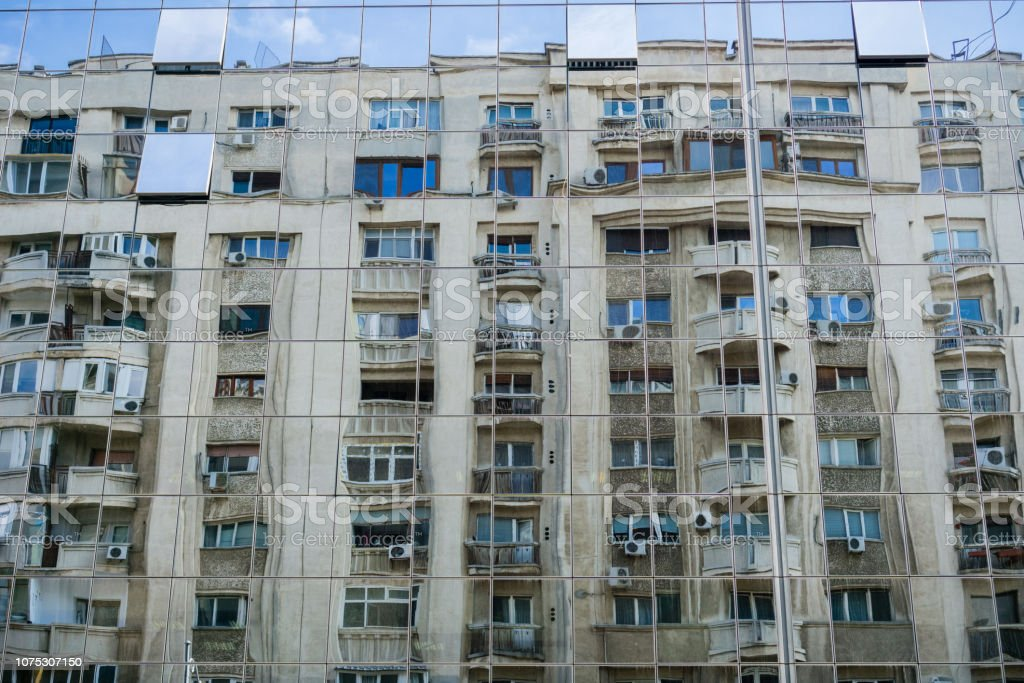 Distorted view of apartment building, Bucharest stock photo