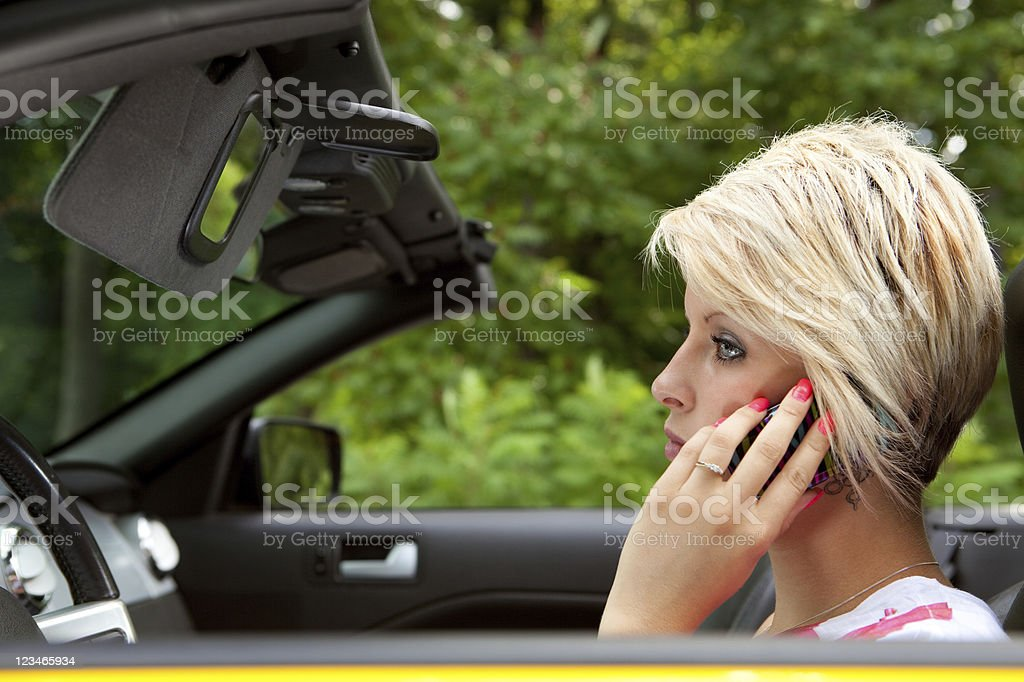 Distracted by cel phone while driving stock photo