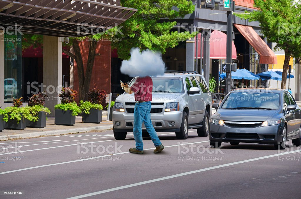 Distracted cell phone user man w head in clouds stock photo