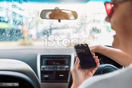 527894422istockphoto Distracted Driver Talking On Mobile Phone 1174007784