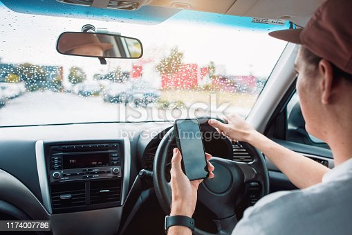 527894422istockphoto Distracted Driver Talking On Mobile Phone 1174007786