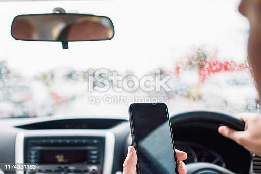 527894422istockphoto Distracted Driver Talking On Mobile Phone 1174331163