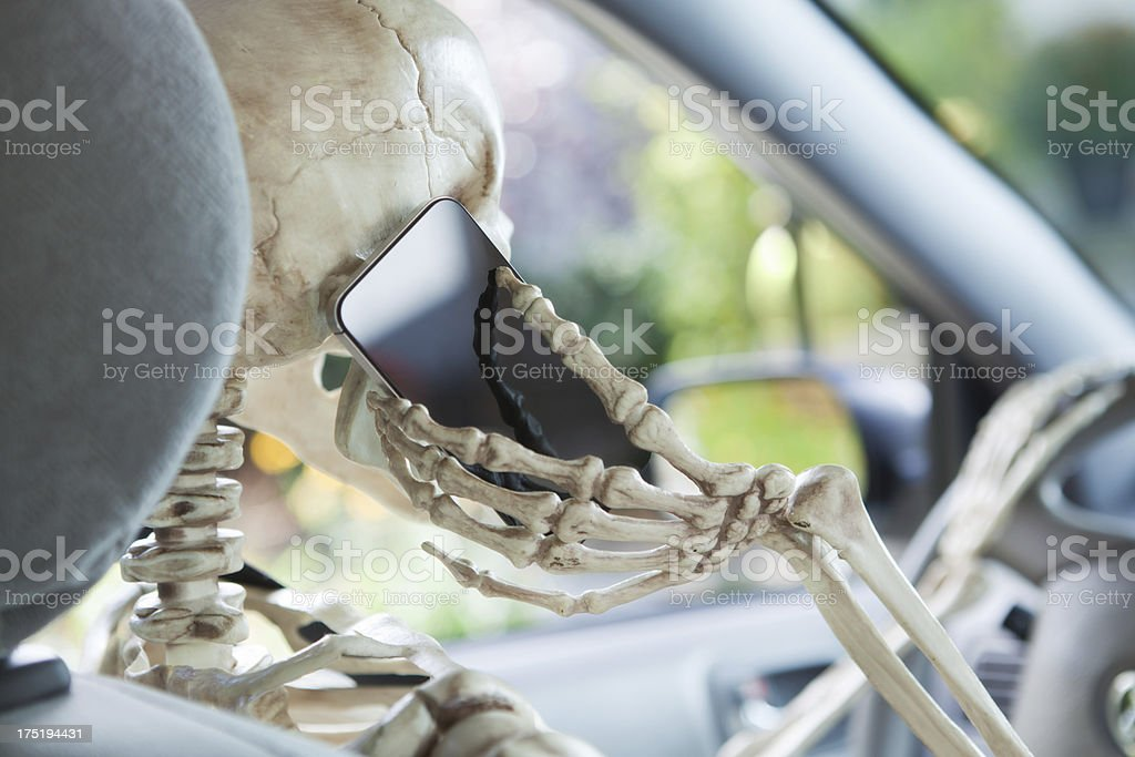 Distracted Driver Using Mobile Phone While Driving in Car Hz royalty-free stock photo