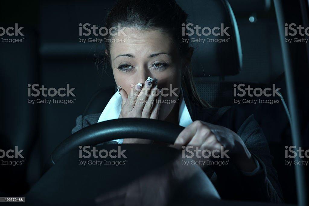 Distracted driving at night stock photo