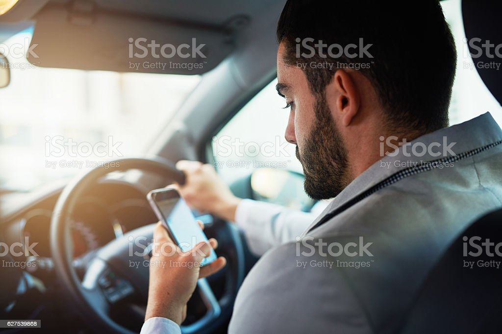Distracted driving can increase the chance of a road accident - foto de stock
