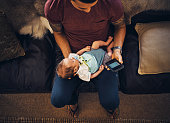 istock Distracted from daddy duties 823789824