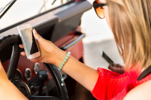 Distracted Teenage Girls Texting While Driving A Vehicle Cell Phone Stock Photo - Download Image Now