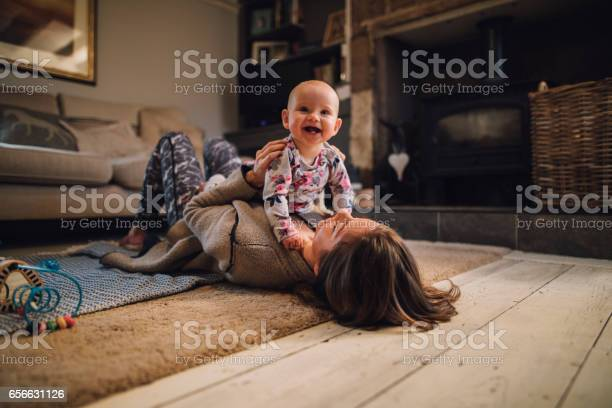 Distracting Mum From Yoga Stock Photo - Download Image Now