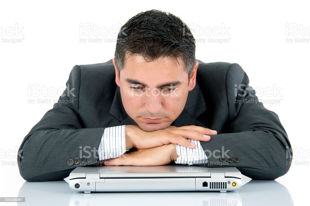 distraught businessman with laptop royalty-free stock photo