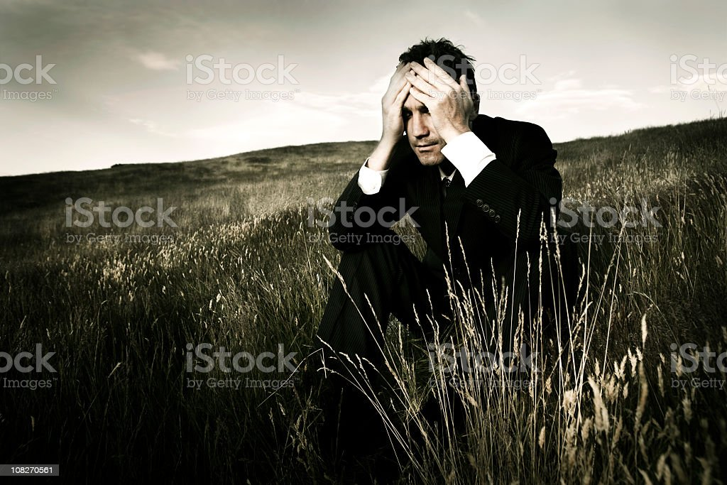 Distraught lonely businessman royalty-free stock photo