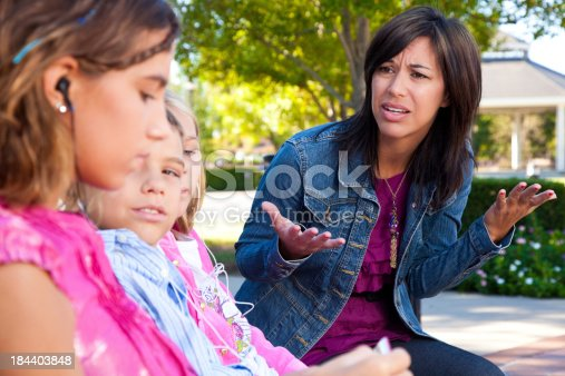 istock Distraught mother with her kids listening to music 184403848