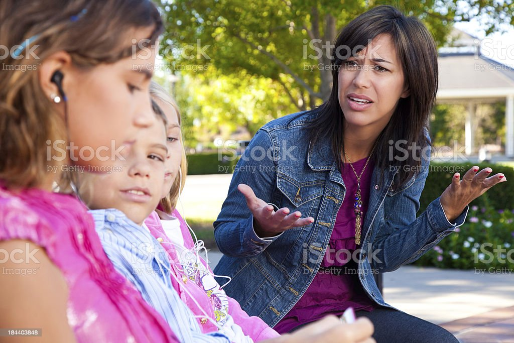 Distraught mother with her kids listening to music stock photo