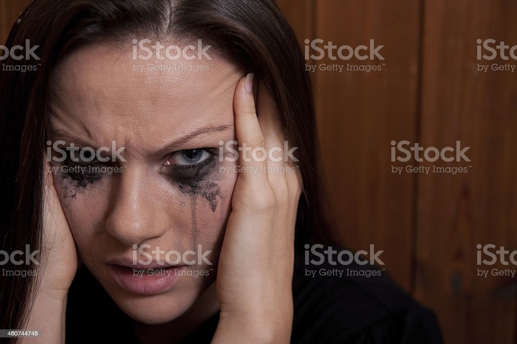 Distraught & Tearful Young Woman stock photo