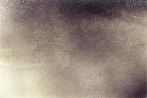 Distressed blurred abstract vintage background brown pastel spots on a yellow background and light spots, with traces of stains and grain, scratches, dirt. Background for design.