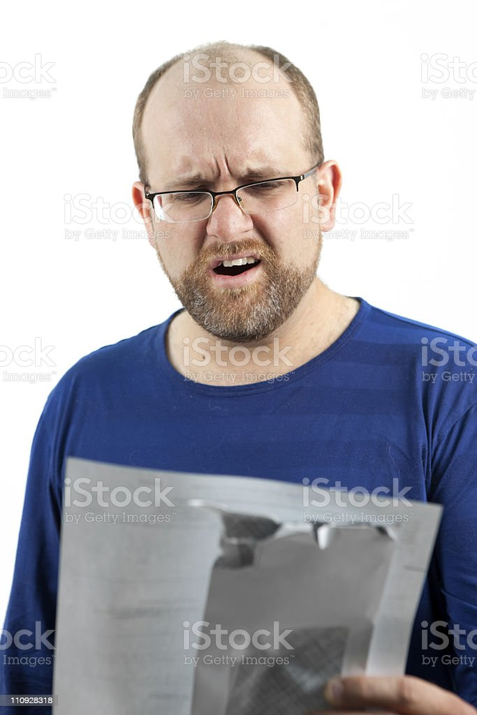 Distressed man holding bill, isolated on white. royalty-free stock photo