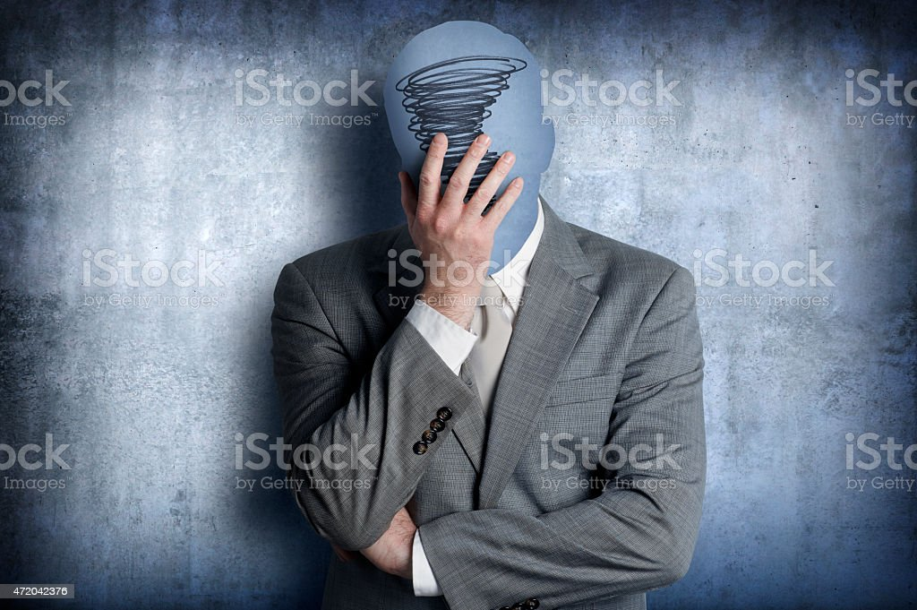 Distressed man with his head in his hands stock photo