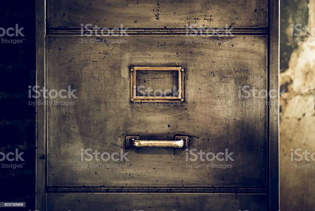 Distressed metal filing cabinet stock photo