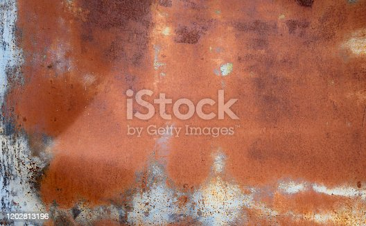 This is an abstract color photograph of a distressed metal background from a vintage car in the desert of Namibia, Africa.
