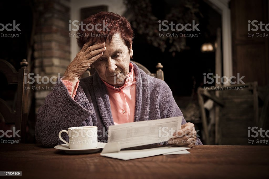 Distressed Senior Woman with Bills stock photo