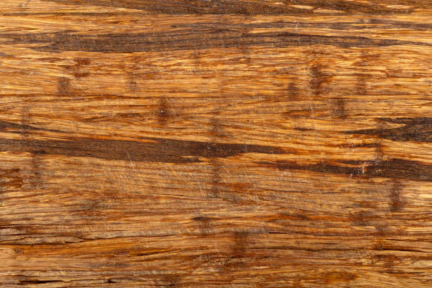 Distressed Wooden Cutting Board Background Old scratched wooden cutting board texture background. block shape stock pictures, royalty-free photos & images
