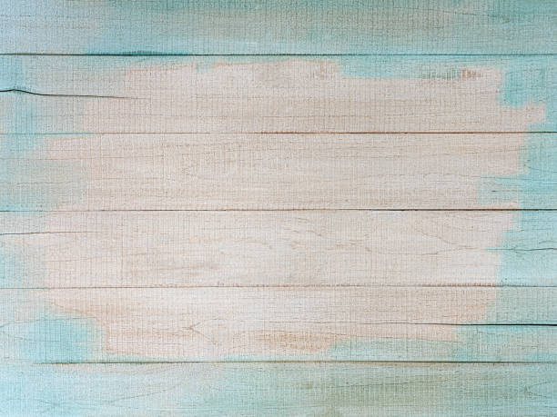 Distressed, worn, weathered, old, blue and white, wooden panel abstract background. stock photo